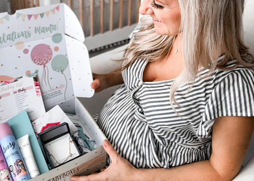 mom opening pregnancy subscription box